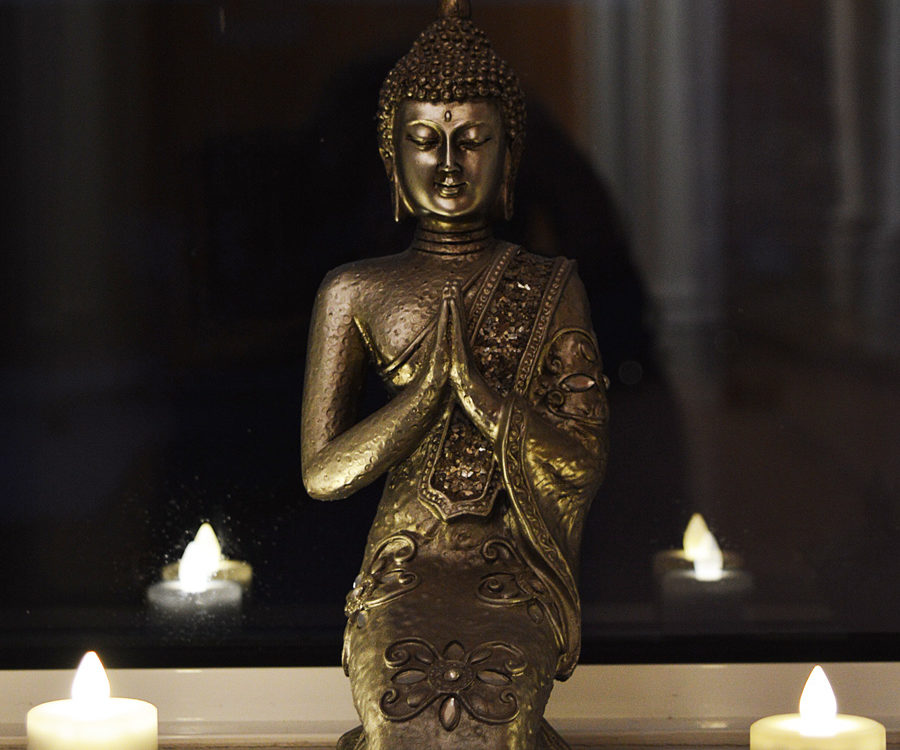 small Buddha with candles